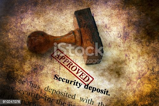 istock Security deposit  - approved grunge concept 910247076