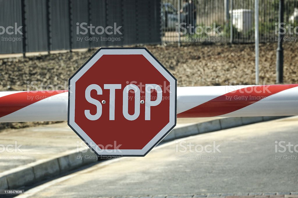 Security entry with big red Stop sign on the beam stock photo