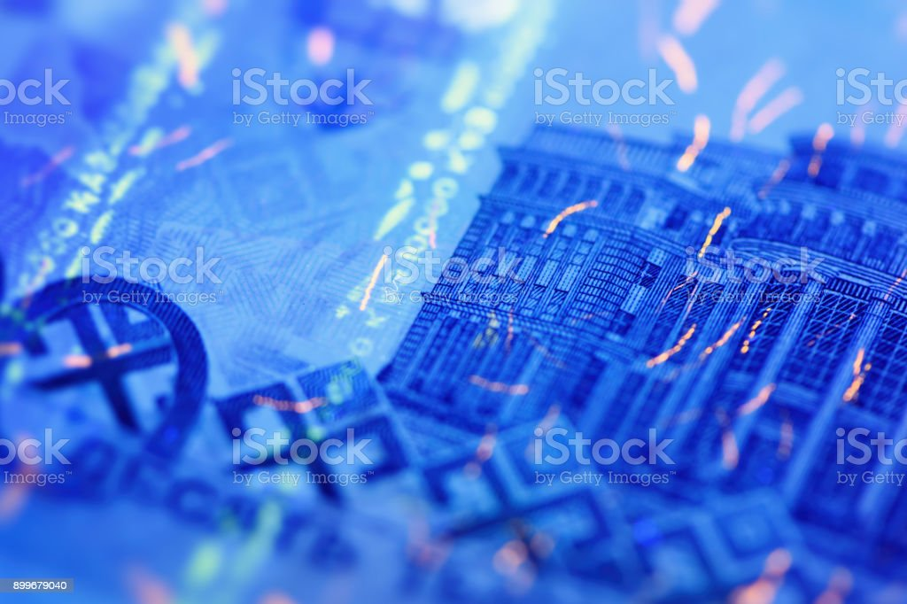 Security features on banknote in UV light protection, abstract background of money stock photo