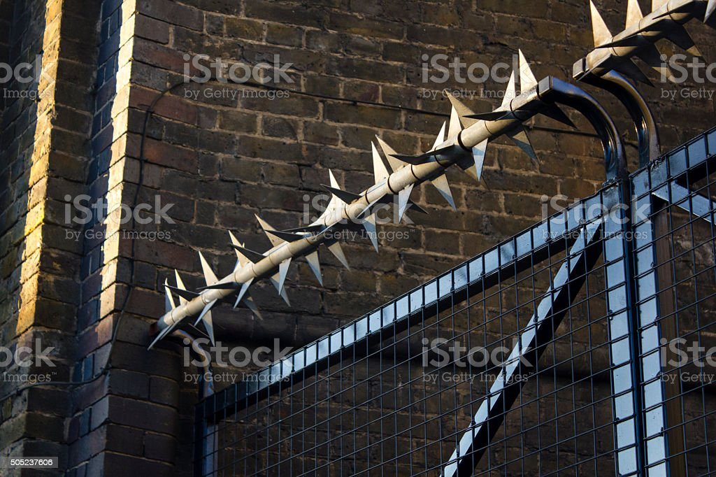 Security gate in sunlight stock photo