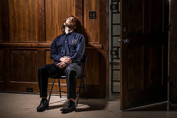 Security guard asleep at his post at night. – Foto