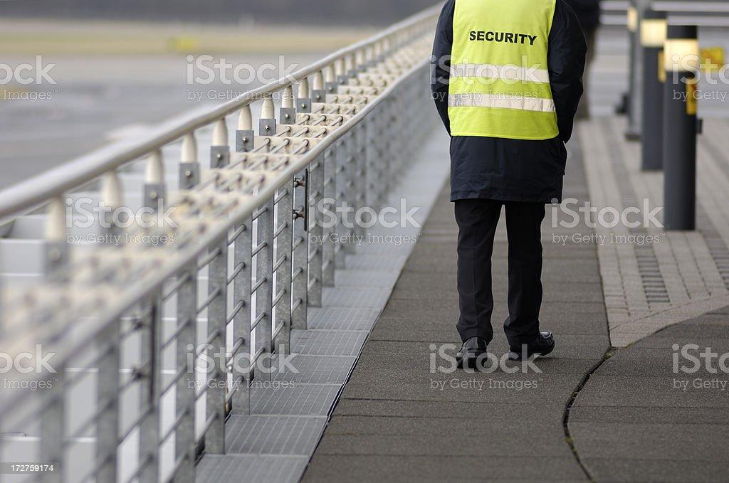 Wachmann am Flughafen - Lizenzfrei Abflugbereich Stock-Foto
