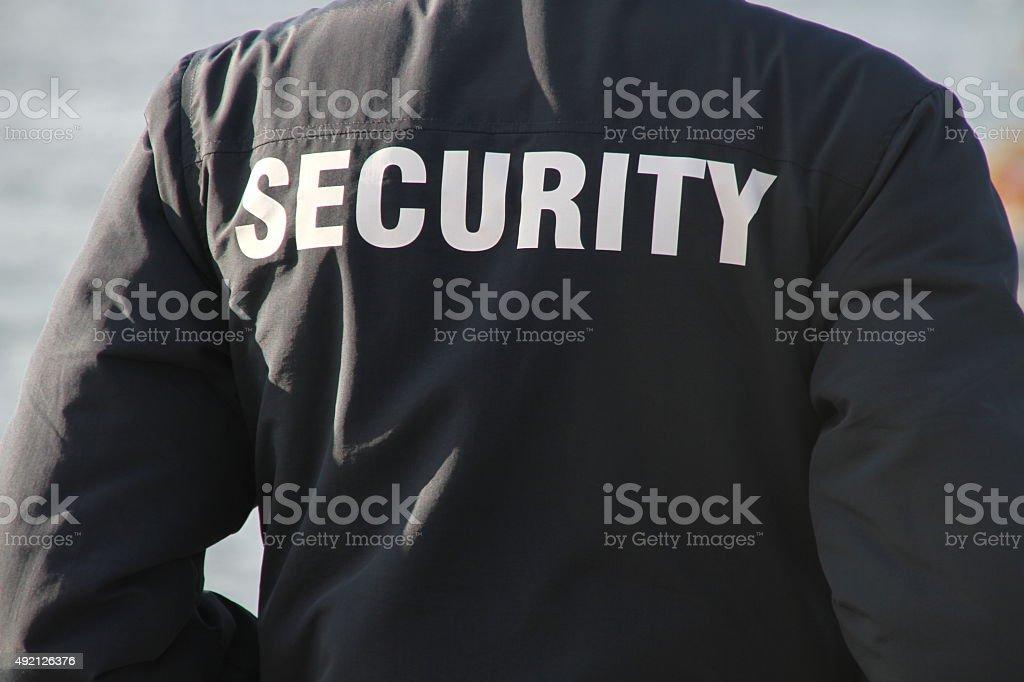 Agent de sécurité arrière gros plan - Photo