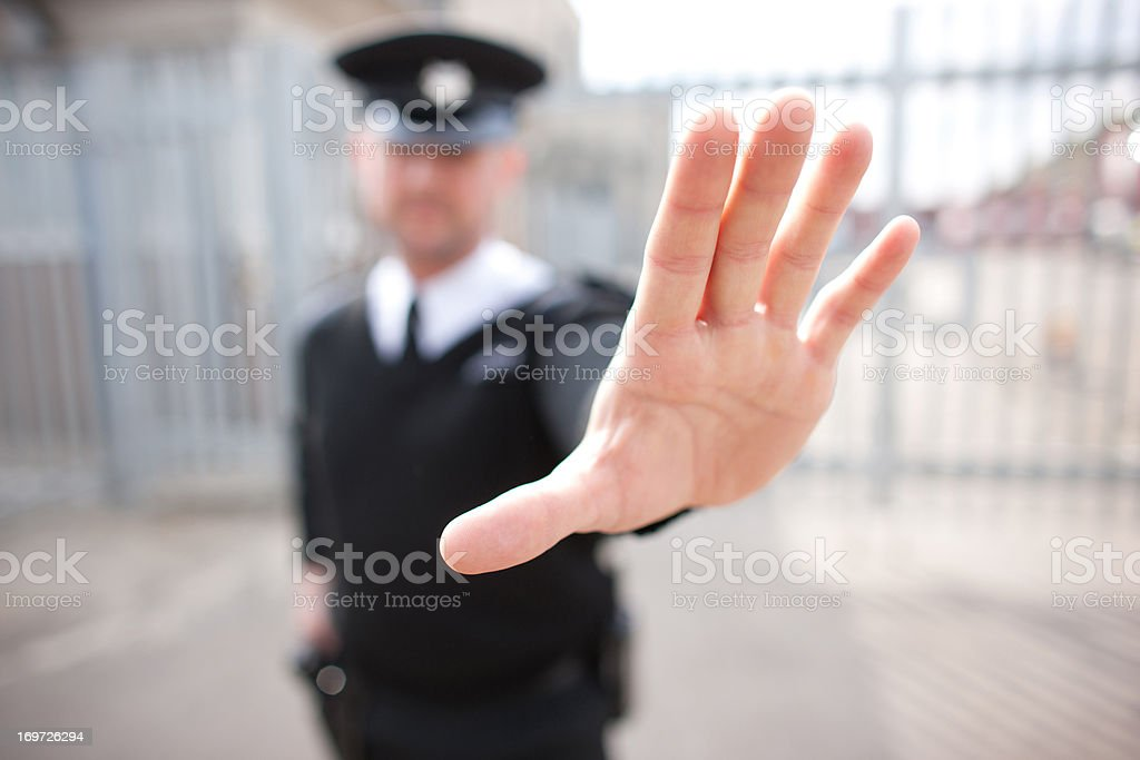 Security guard holding hand out stock photo
