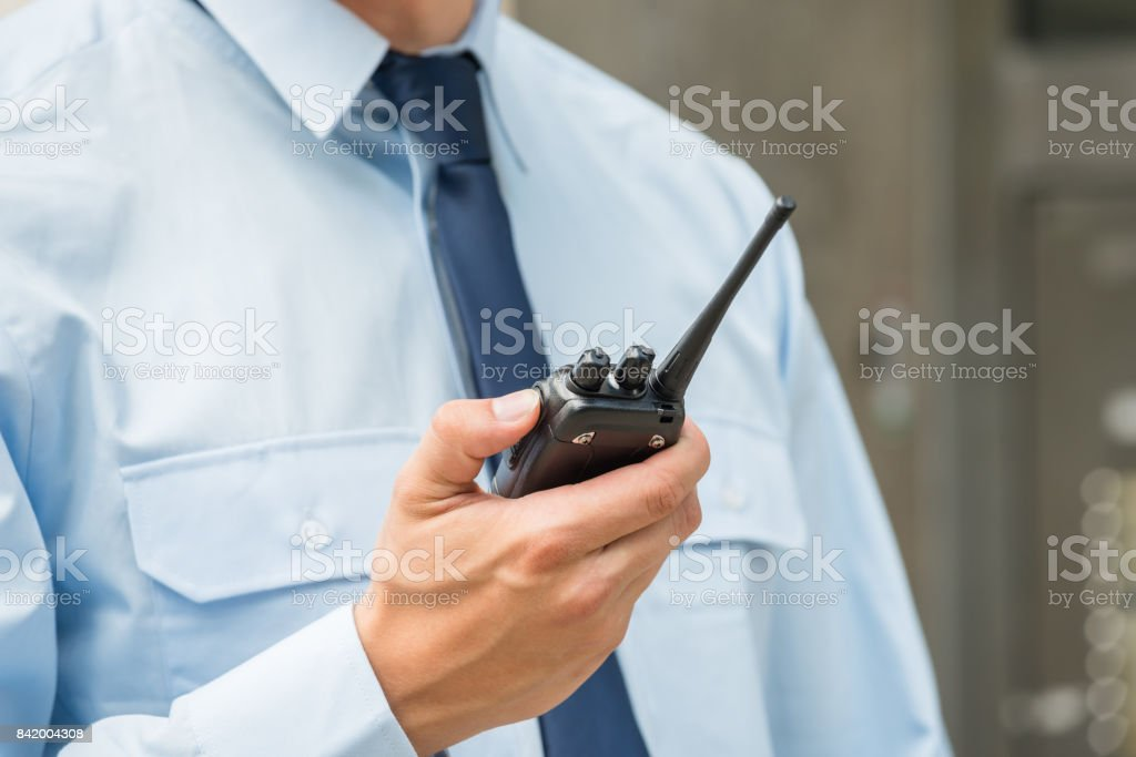 Security Guard Holding Walkie-talkie stock photo