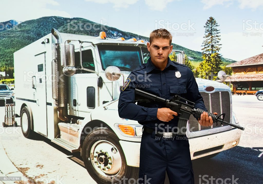 Security guard in action with rifle outdoors stock photo