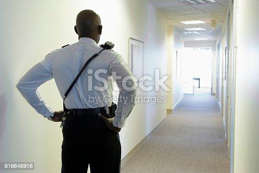 istock Security guard in an office corridor 516646916
