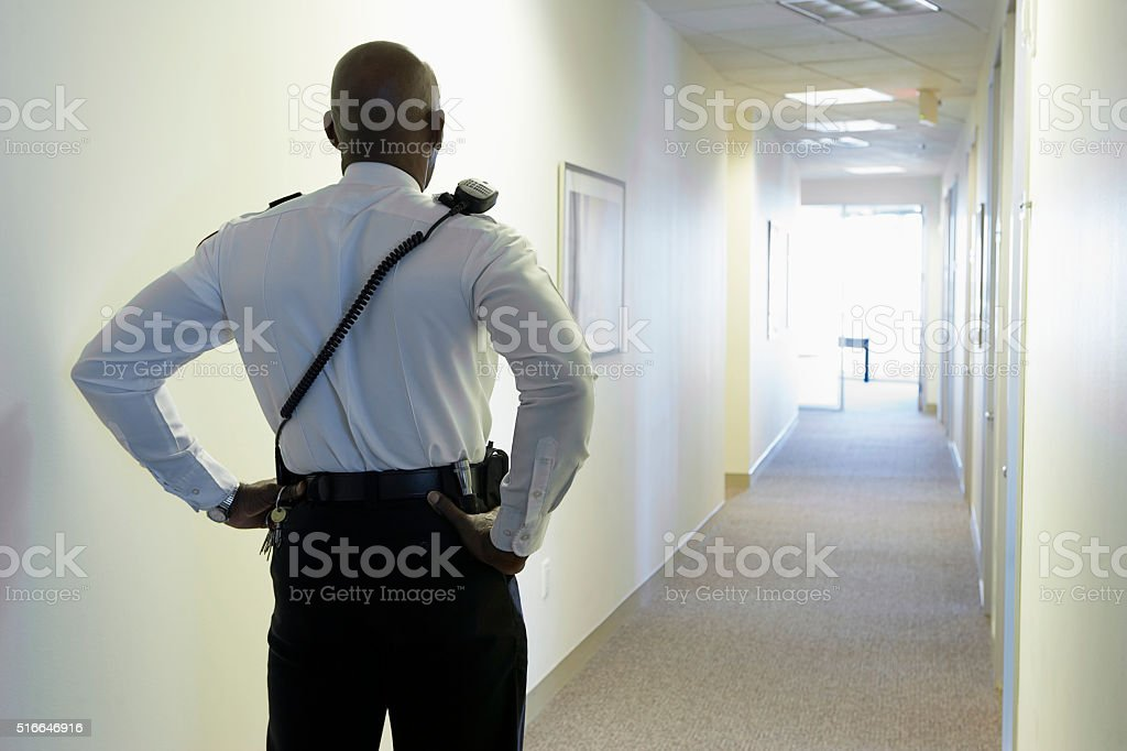 Security guard in an office corridor stock photo