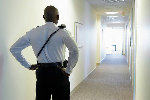 Security guard in an office corridor - Photo