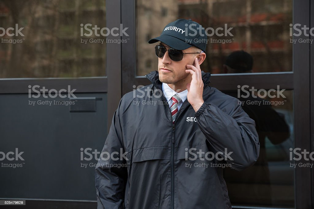 Security Guard In Front Of The Door Entrance stock photo