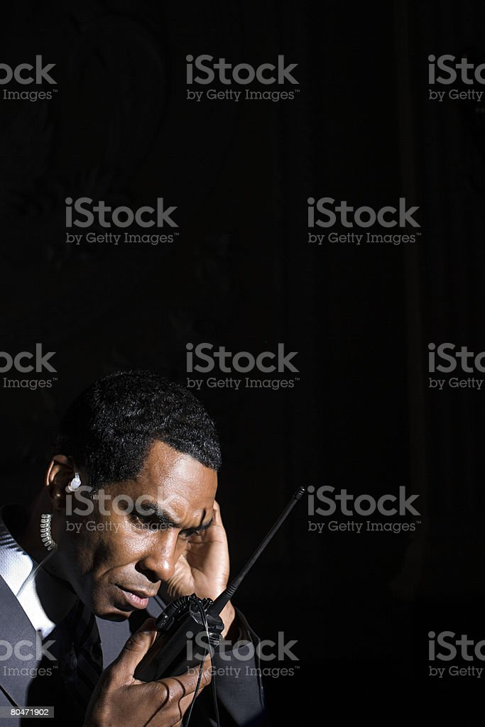 A security guard listening to his walkie talkie royalty-free 스톡 사진