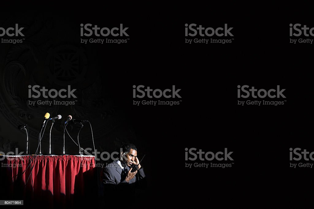 A security guard listening to his walkie talkie 免版稅 stock photo