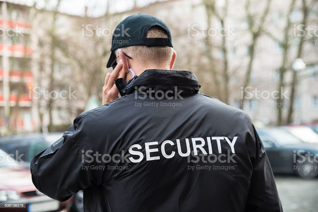 Security Guard Listening With Earpiece stock photo