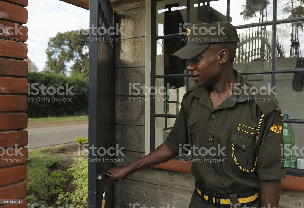 security guard opening door, nairobi, kenya stock photo