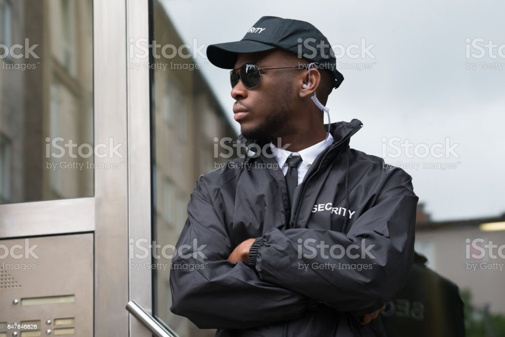 Security Guard Standing Arms Crossed stock photo