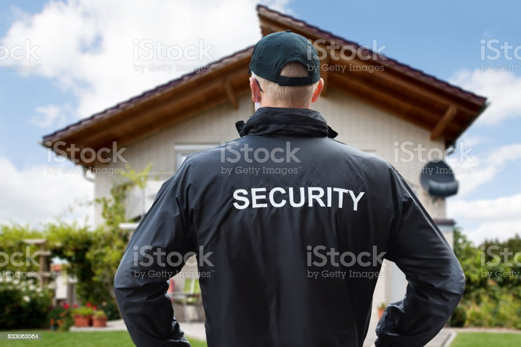 Security Guard Standing Outside The House stock photo