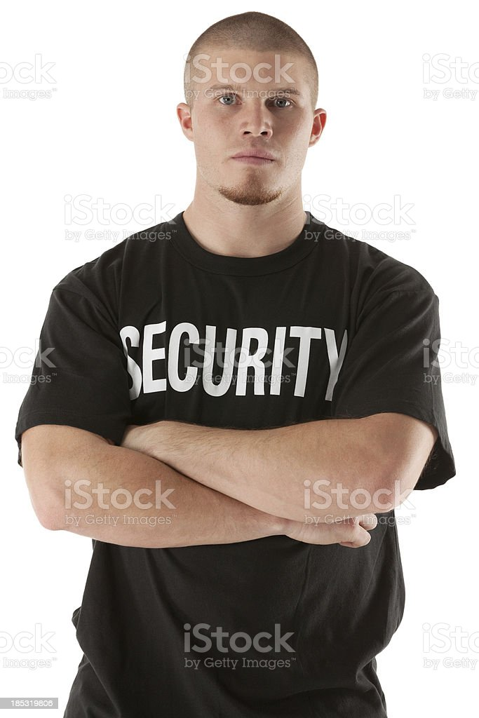 Security guard standing with his arms crossed stock photo