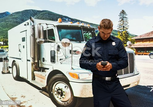 Security guard using phone outdoors