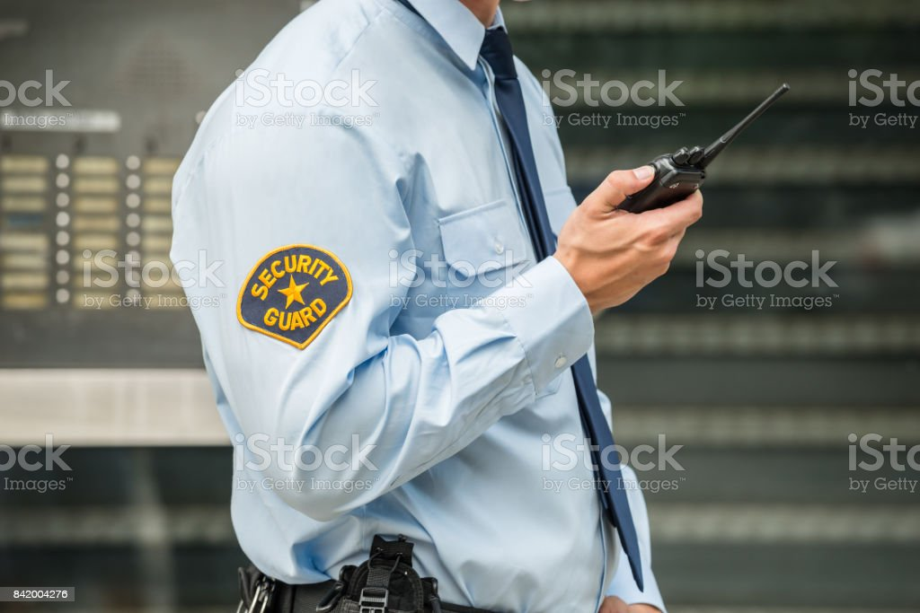 Security Guard Using Walkie-talkie stock photo