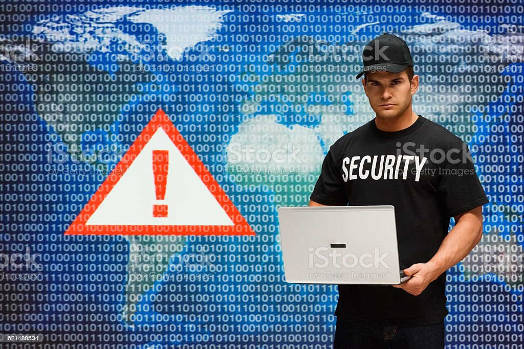 Security guard working on laptop Lizenzfreies stock-foto
