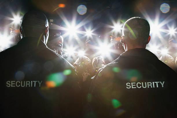 Security guards blocking paparazzi picture id130406310?b=1&k=6&m=130406310&s=612x612&w=0&h=ude4c2kfrnjonpqbiaervxtu9ieqnis2  kxnqfe mk=