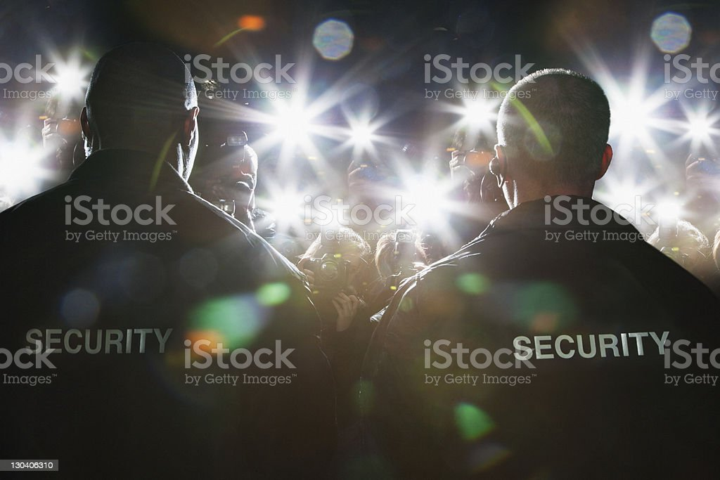 Security guards blocking paparazzi stock photo