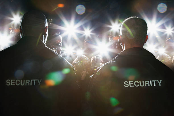 security guards blocking paparazzi - protection stock photos and pictures