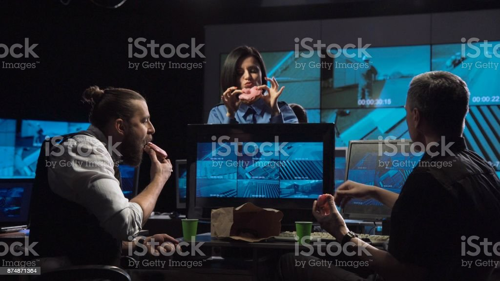 Security guards watching the surveillance cameras stock photo