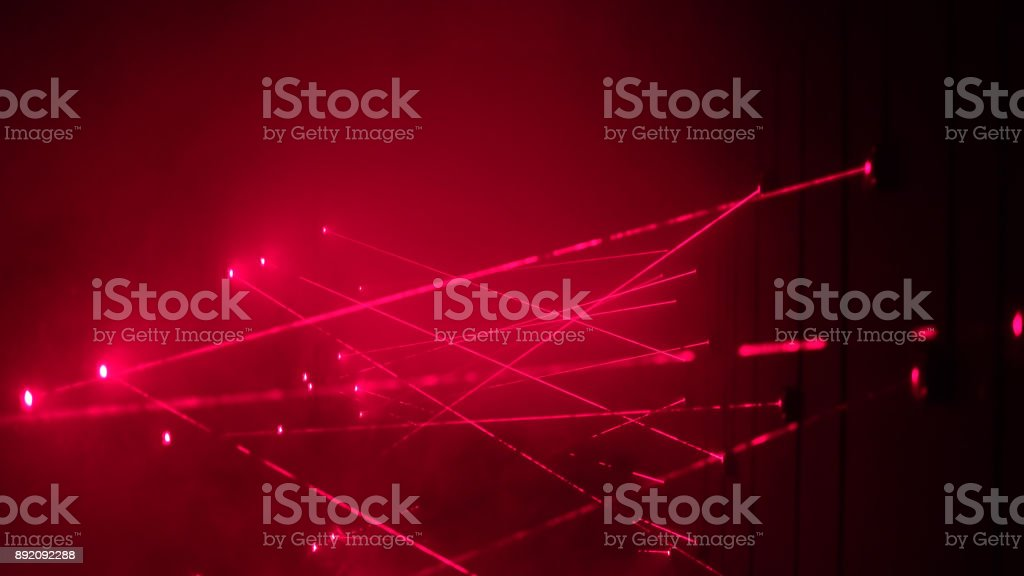 Security laser system alarms when thief try to rob bank and fails in crossing red beam stock photo