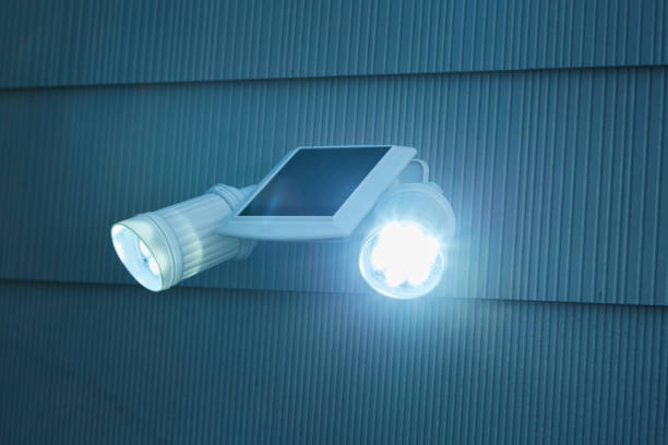 Security light on the exterior of house. stock photo