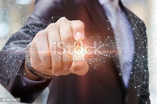 istock Security Lock in the hand of businessman. 673574420