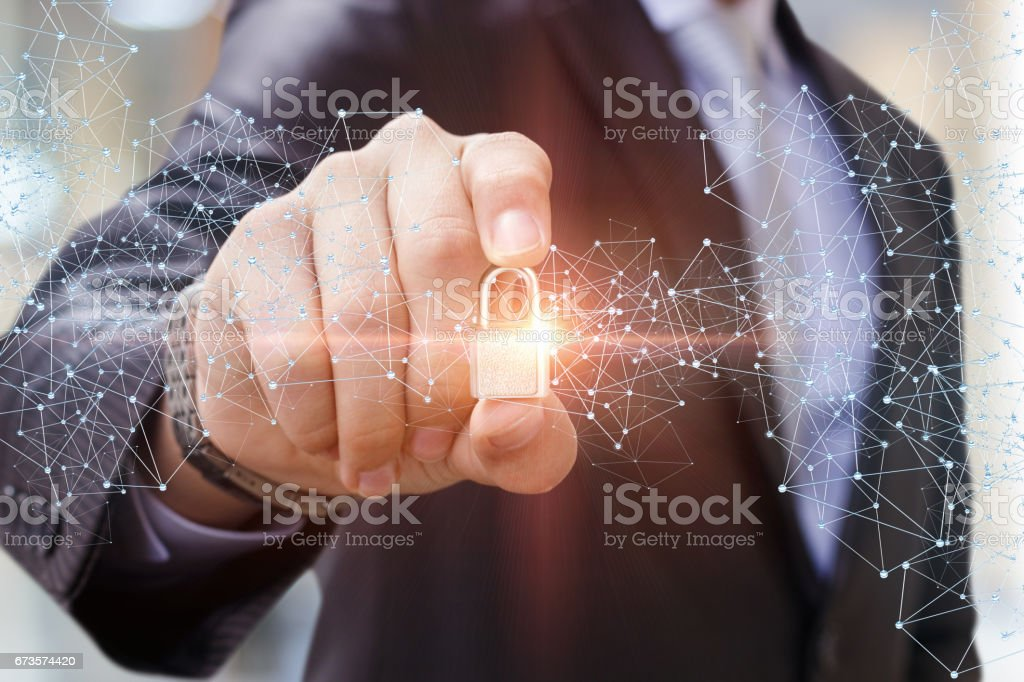 Security Lock in the hand of businessman. stock photo
