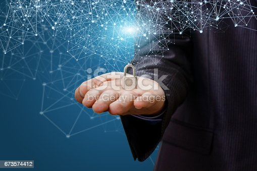 istock Security Lock in the palm . 673574412