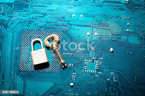 istock security lock on a circuit board with key 636198644