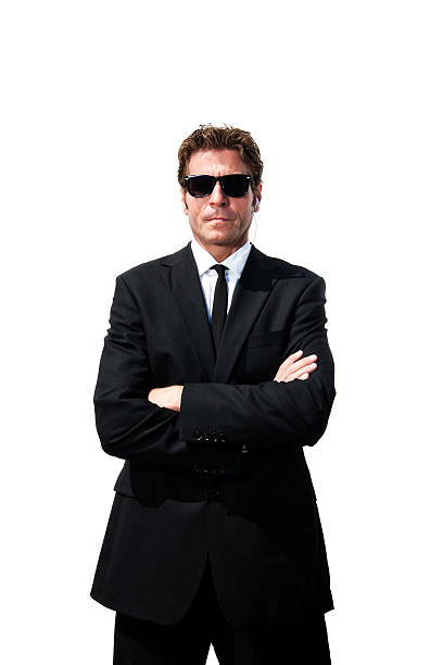 Security Man in Black Suit stock photo