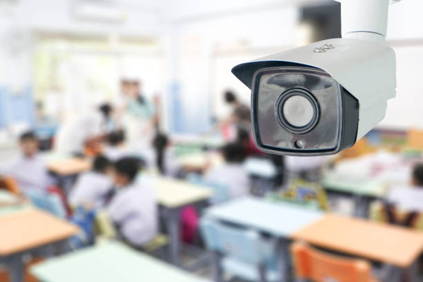 CCTV Security monitoring student in classroom at school.Security camera surveillance for watching and protect group of children while studying. stock photo