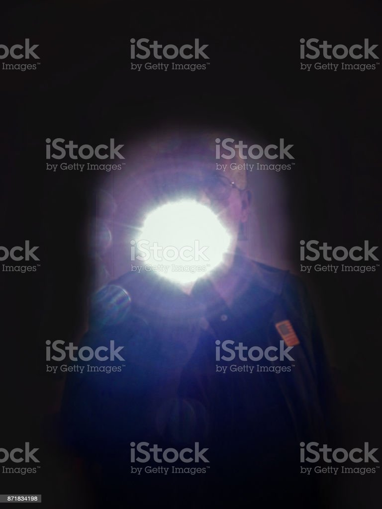 Security Officer Shines His Flashlight into the Darkness - Action Photo of Security Guard on Night Duty stock photo
