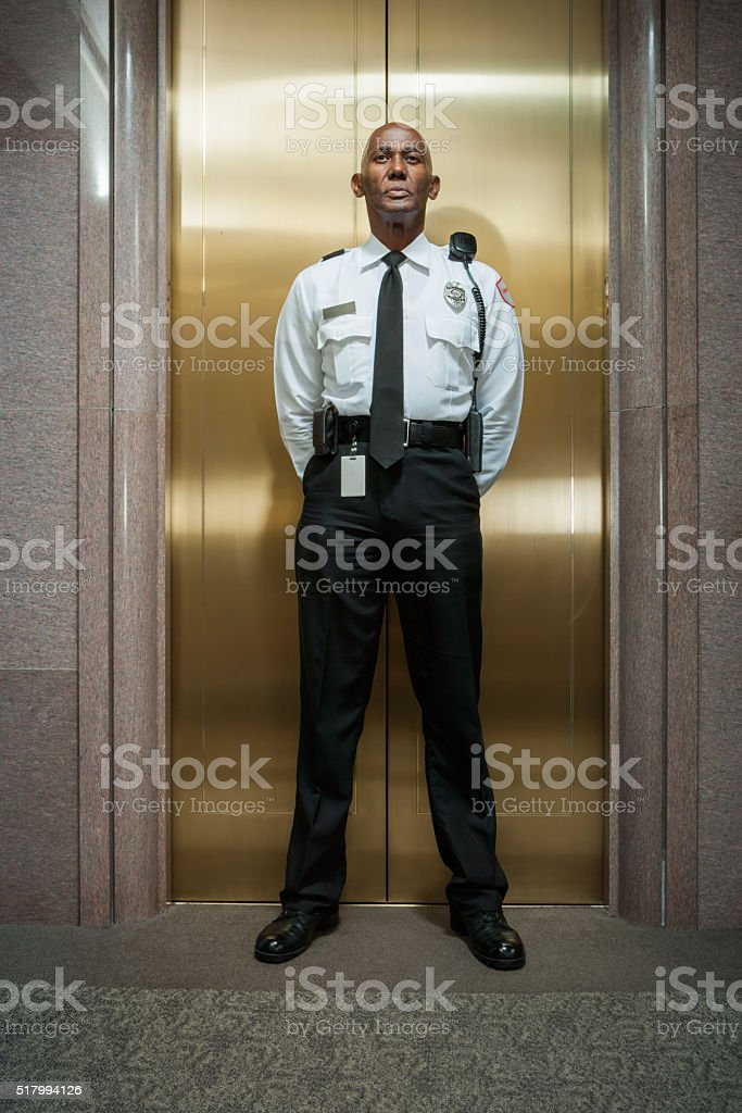Security peronnel standing guard stock photo