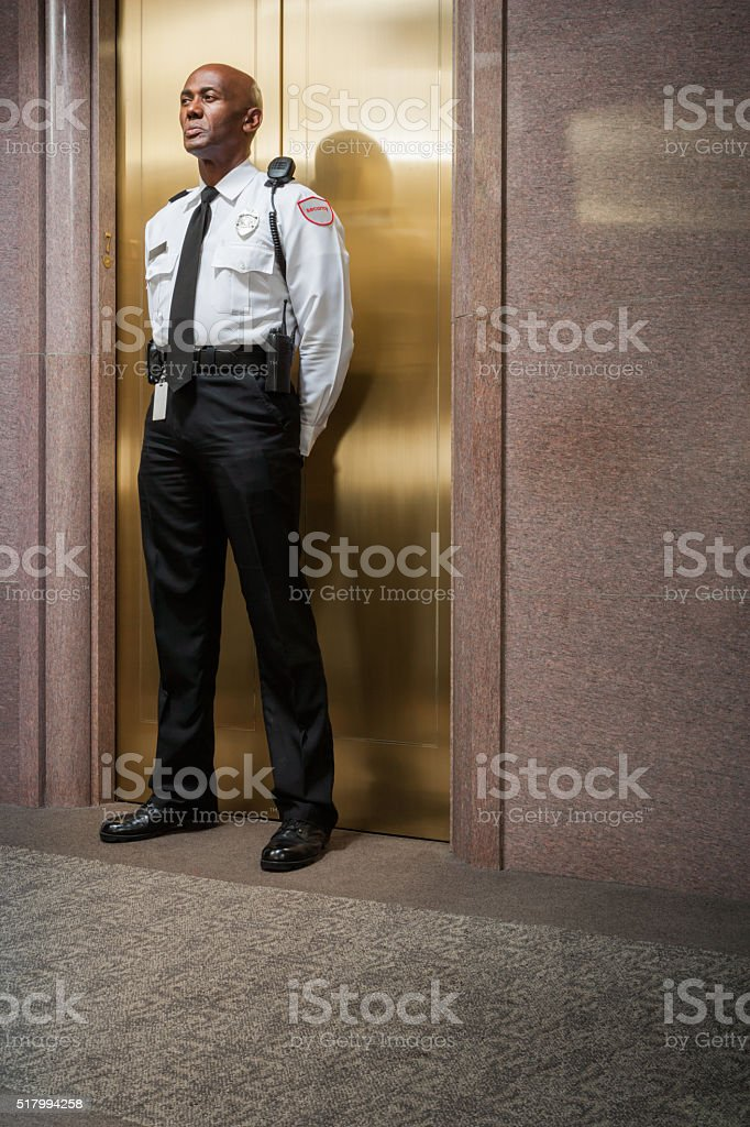 Security peronnel standing guard - Photo