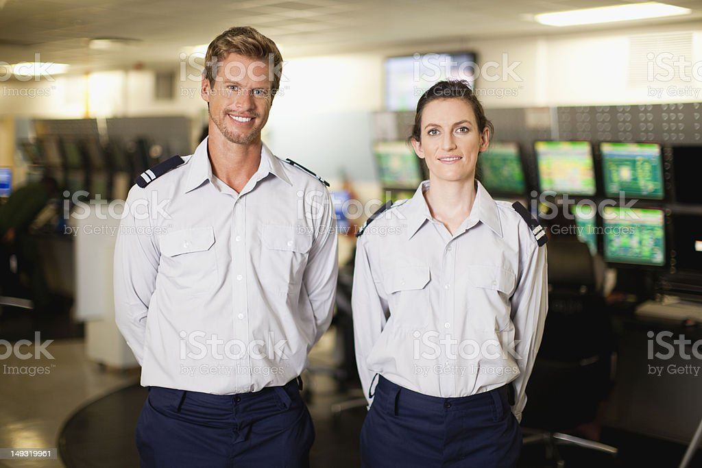 Security personnel in control room stock photo
