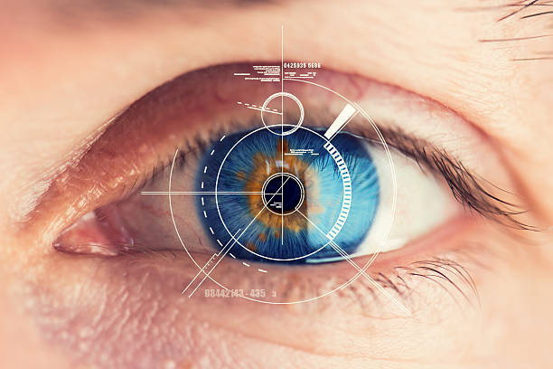 Security Retina Scanner on blue eye Stunning blue eye with an abstract Security Retina Scanner attached – great detail in the eye! biometrics stock pictures, royalty-free photos & images