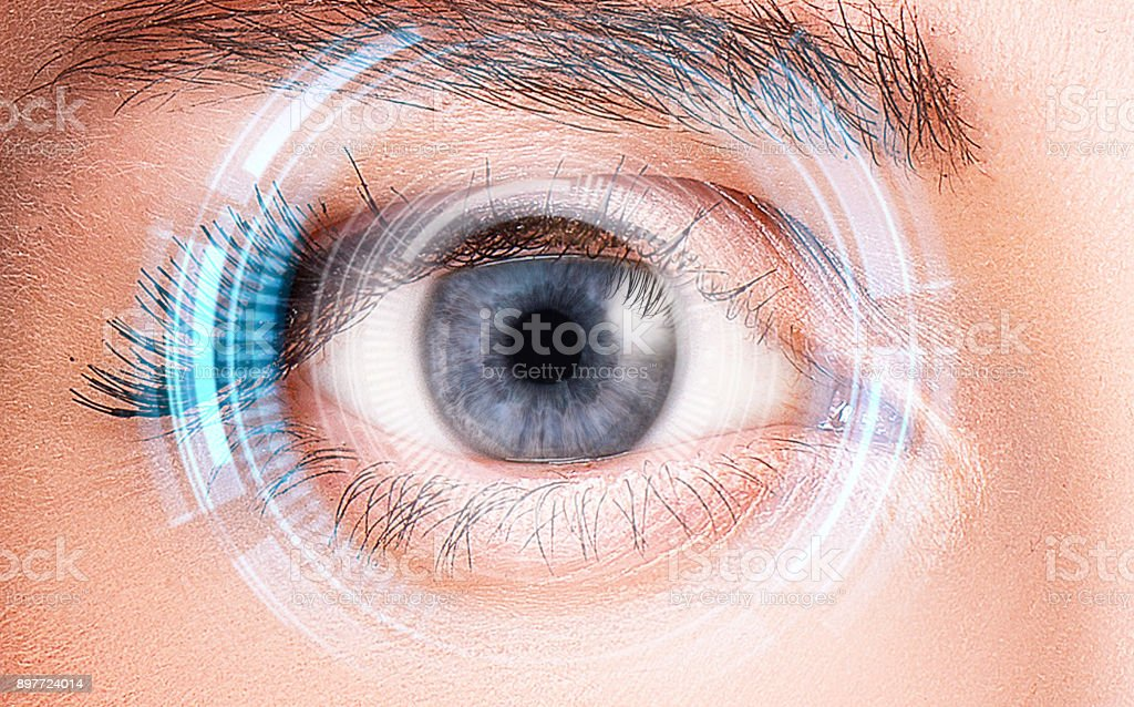 Security retina scanner on woman blue eye stock photo