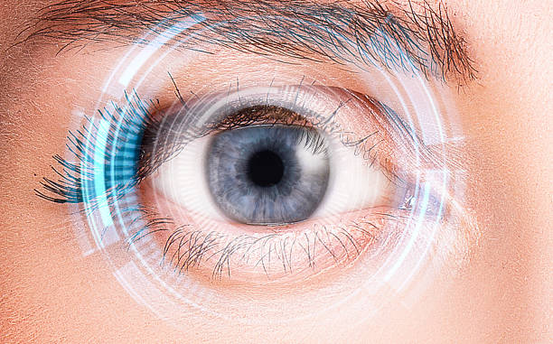 security retina scanner on woman blue eye - optometrist stock pictures, royalty-free photos & images