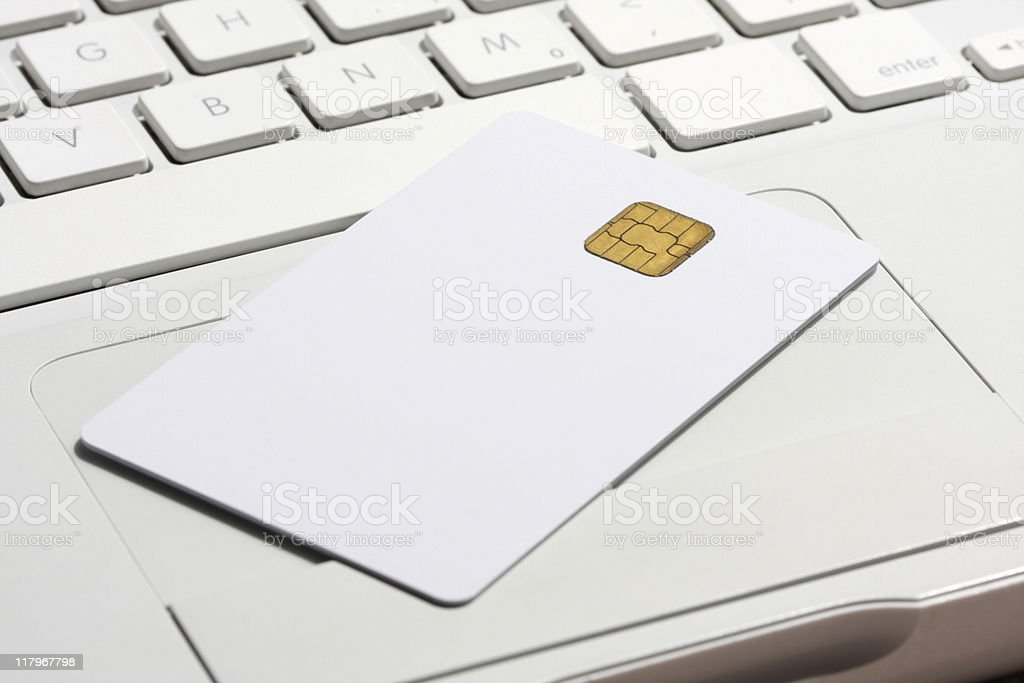 Security smart card on laptop keyboard. stock photo
