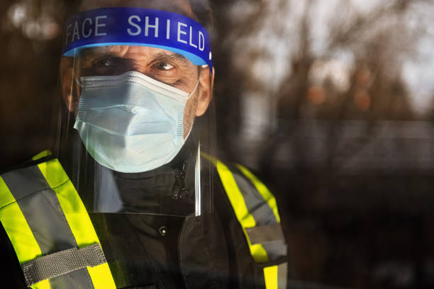 Security staff photographed through window stock photo