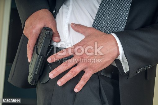 Security staff armed with handgun.