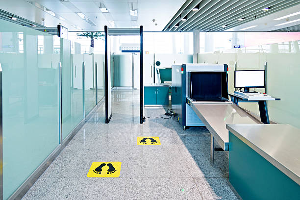 Security station Security station in an airport. security barrier stock pictures, royalty-free photos & images