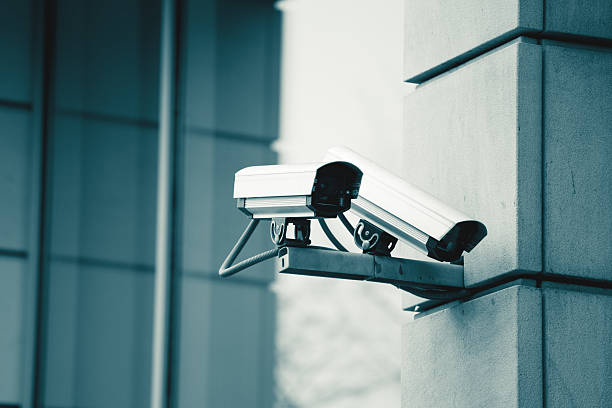 cctv security surveillance camera - big brother orwellian concept stock pictures, royalty-free photos & images
