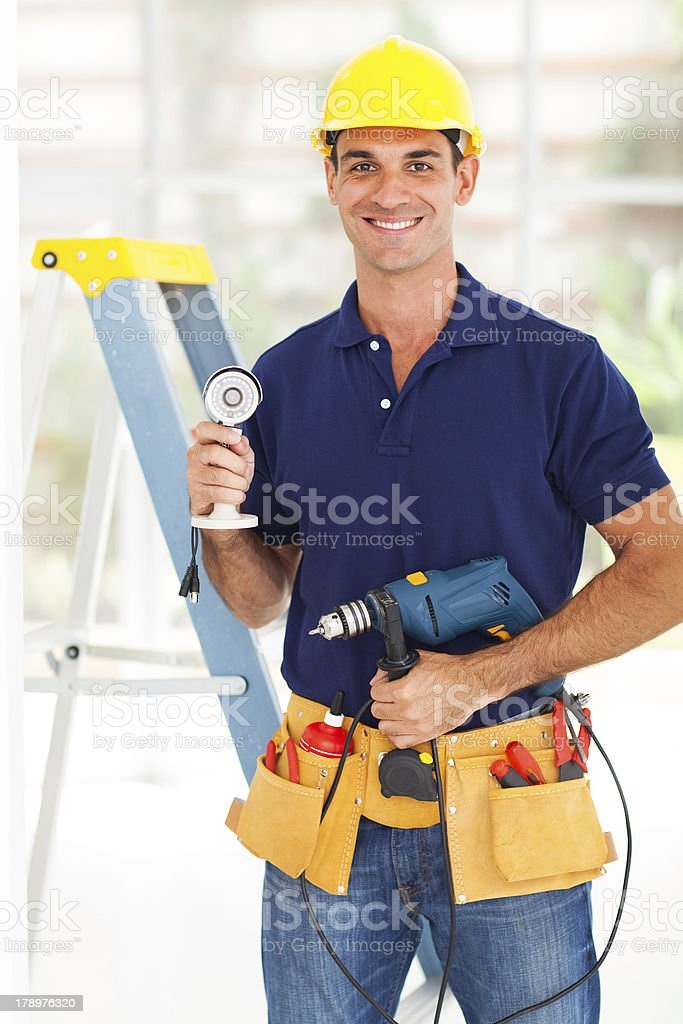 security surveillance system installer stock photo