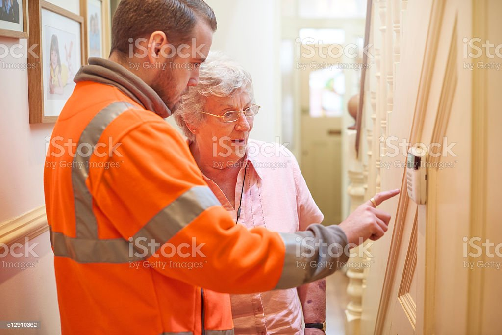 security system for senior woman stock photo